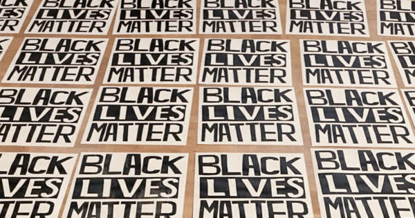Rows of screen printed posters reading BLACK LIVES MATTER
