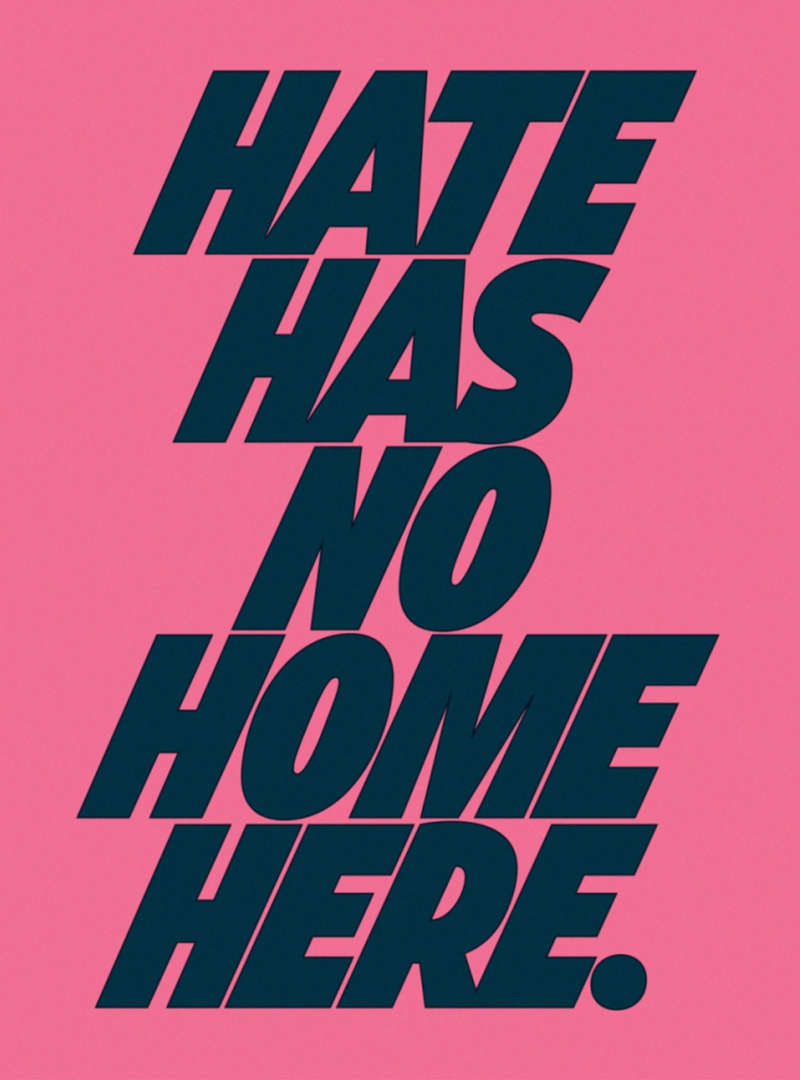 """Blue type on pink paper reads """"Hate Has No Home Here."""""""