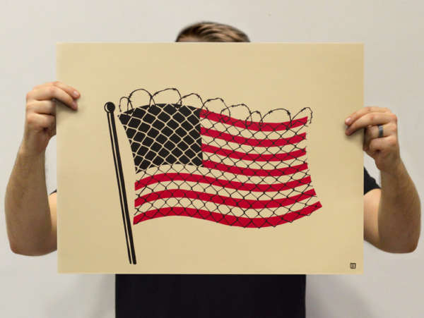Photo of a print with a waving American flag wrapped in chain link with razor wire across the top.