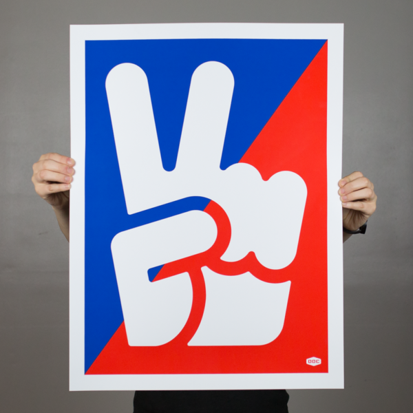 "Person holding a screen print of a hand icon giving the ""peace sign"" in the middle of a blue and red ink flood background."