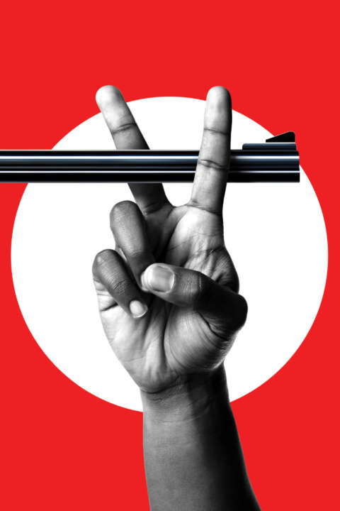 Black and white hand over a bright red background gives a peace sign while ready to cut the barrel off of a gun.