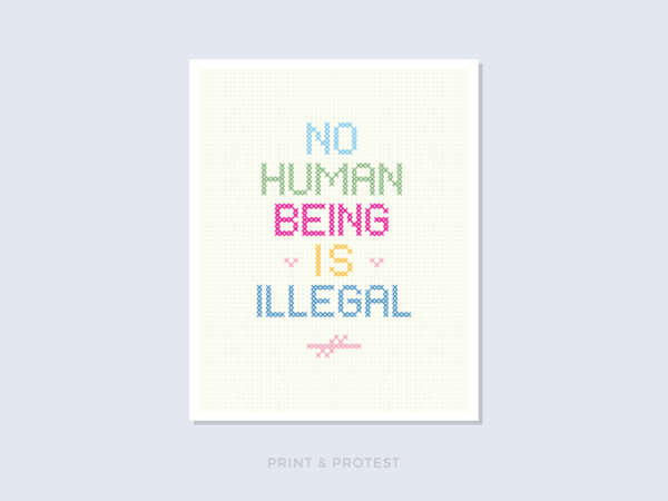 "Colorful poster reads ""No Human Being Is Illegal."""