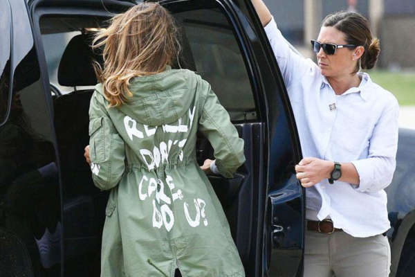 First lady Melania Trump gets into her SUV wearing a green jacket with painted type reading 'I Really Don't Care. Do U?'